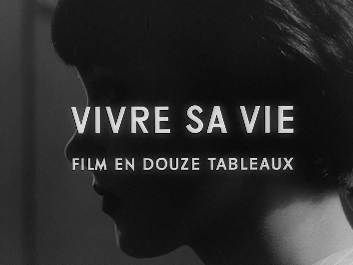 The words 'Vivre Sa Vie: Film En Douze Tableaux' appear over a close up, black and white image of a woman's face in profile.