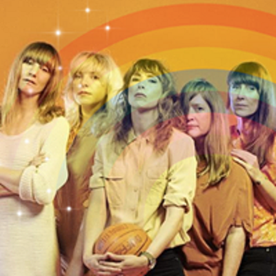 All five members of the beaches (all women) stand looking at the camera. A transparent rainbow overlays the image.