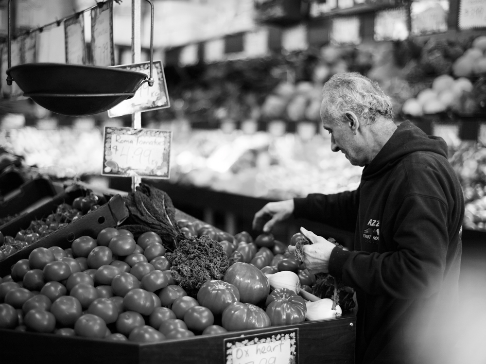 Azzi arranges fruit in his Enmore Road fruit shop