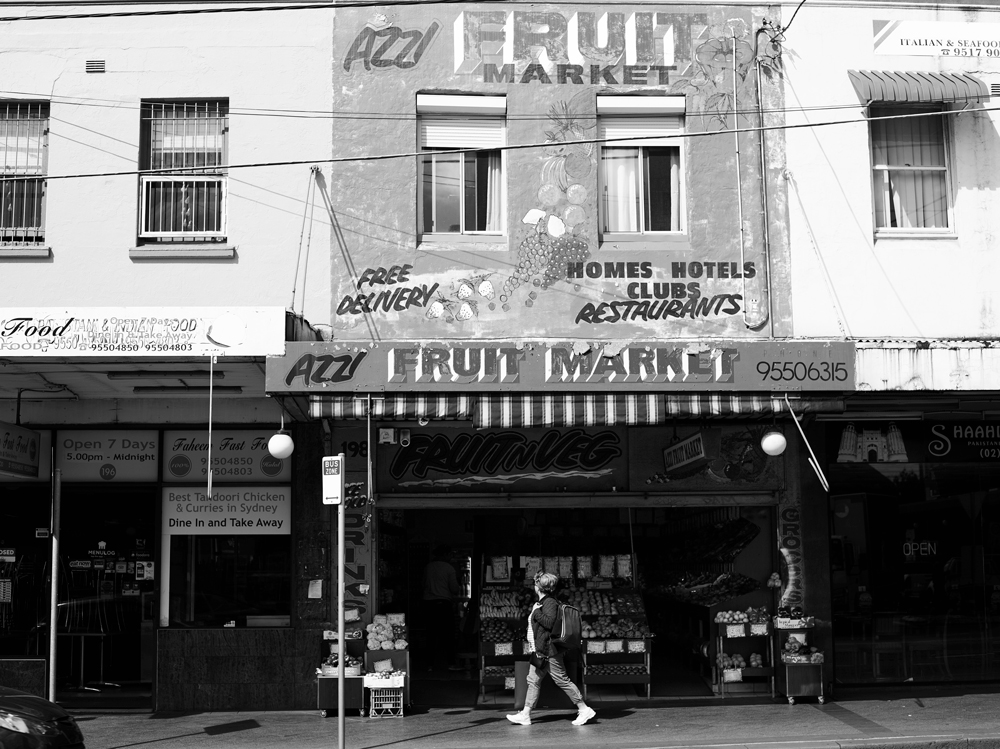 A passer-by outside Mr Azzi's fruit shop, Enmore Road.
