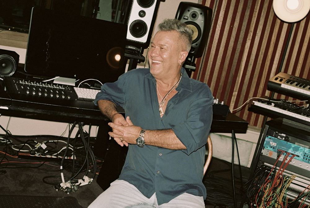 Jimmy Barnes leans on his studio desk at his home in Sydney.