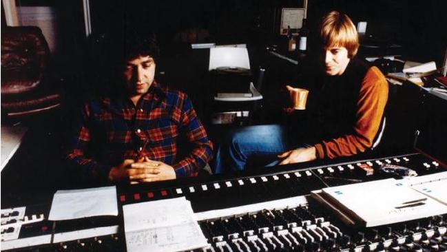 George Young and Harry Vanda sit together at a mixing desk