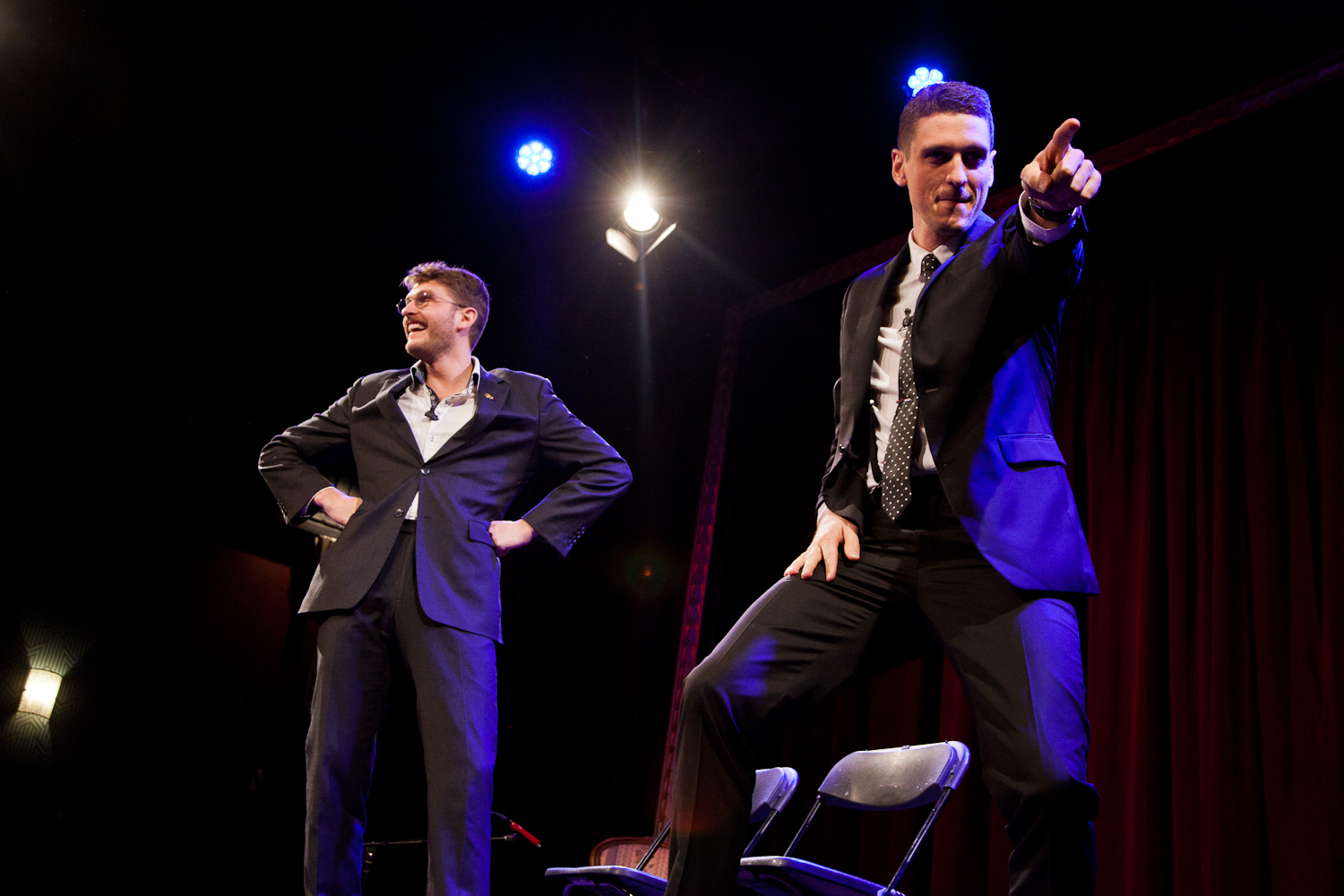 Carlo Ritchie and Steen Raskopoulos posing on stage, in suits.