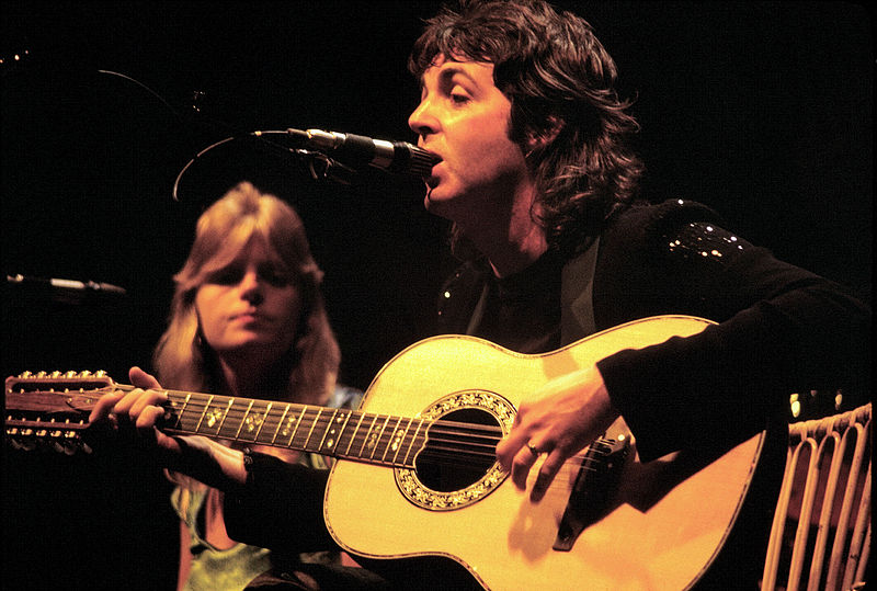 Paul McCartney performing with wife Linda in 1976.