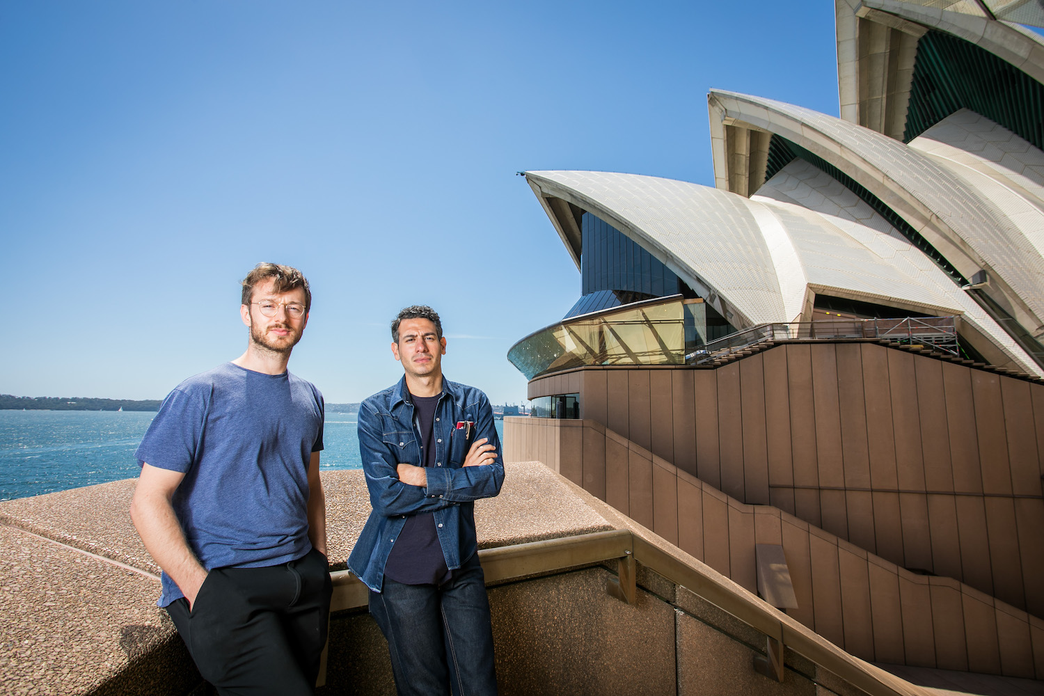 Sydney Biennale artists Oliver Beer and Rayyane Tabet at the Opera House. Photography by Anna Kucera