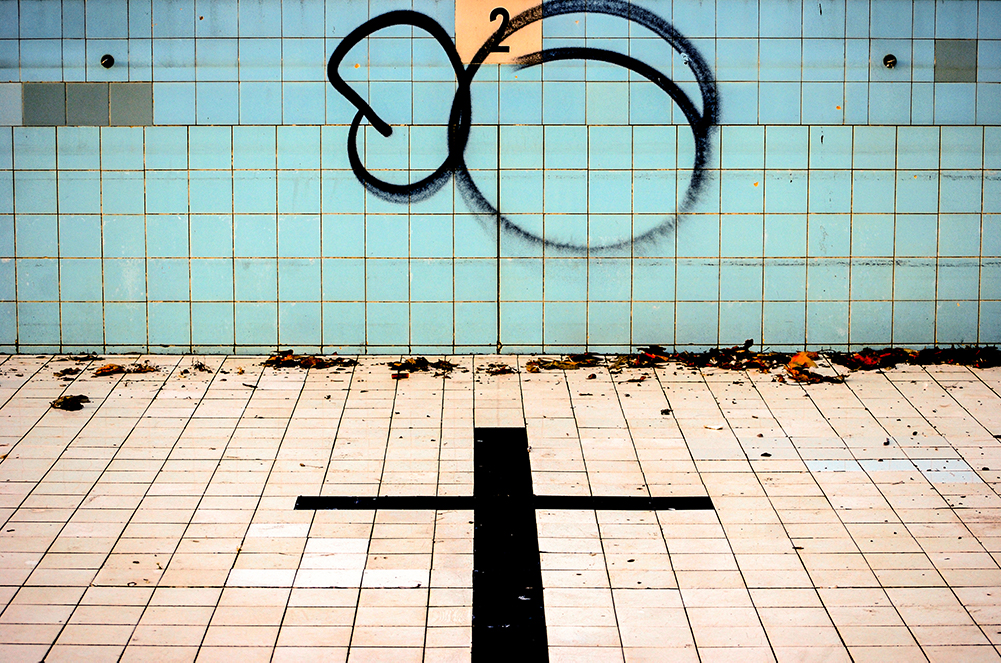 The empty Alfred Park Pool, with graffiti on the tiles