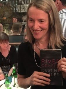 Justine Ettler, 'Ophelia' book launch, 2018. Justine, smile, holds the new edition of her book.