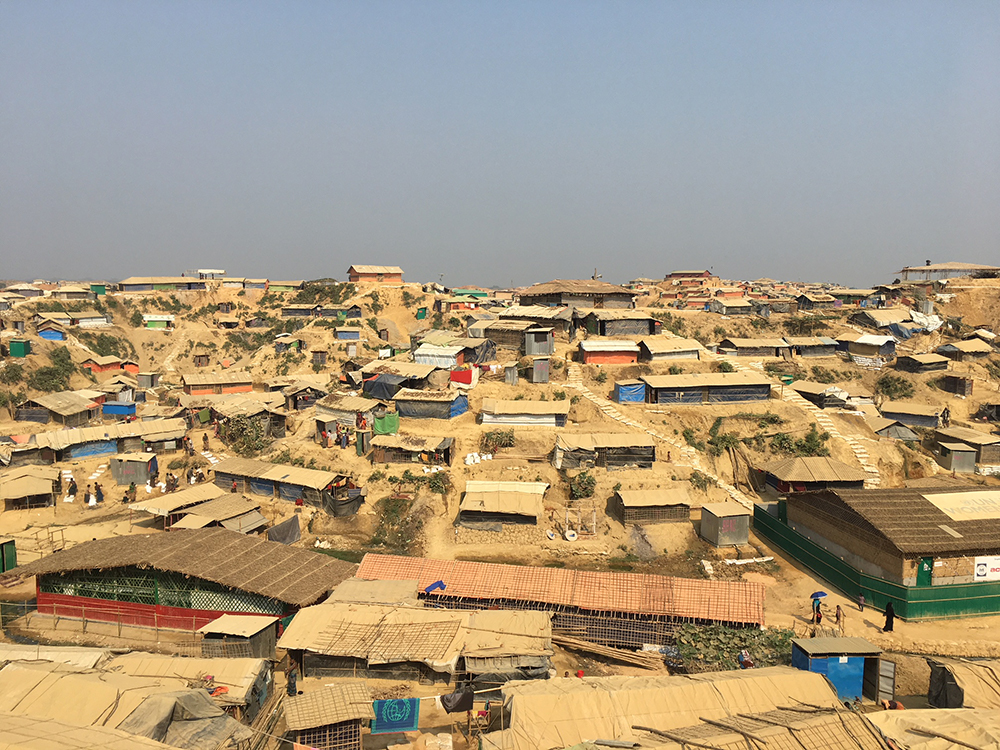 Wide view of makeshift houses built on a tiered hill
