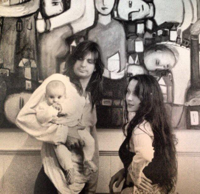 Family photograph of musician Steve Lucas, artist Amanda Meares and baby Madelaine.