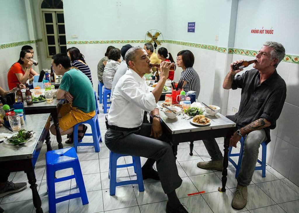Obama and Bourdain enjoy a beer in Vietnam.