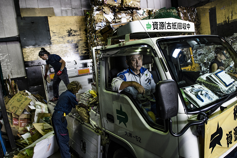 Waste is unloaded at Shizai paper recycling plant, Tokyo, Japan, which has been processing waste since 1969.