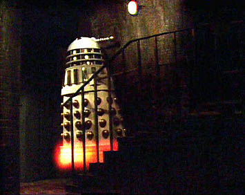 An Imperial Dalek flies up a flight of stairs in 'Remembrance of the Daleks'.